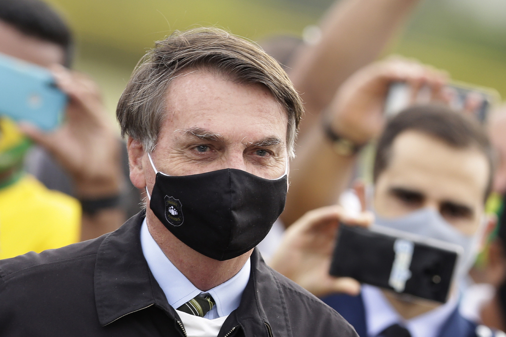 Brazil's President Jair Bolsonaro, shown May 25, 2020, said Tuesday, July 7, he tested positive for COVID-19 after months of downplaying the virus's severity while deaths mounted rapidly inside the country. (AP Photo/Eraldo Peres, File)