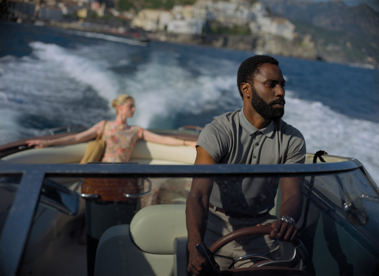 "This image released by Warner Bros. Entertainment shows Elizabeth Debicki, left, and John David Washington in a scene from ""Tenet."" Warner Bros. will release Christopher Nolan's ""Tenet"" internationally first on Aug. 26, with a U.S. release in select cities to follow over Labor Day weekend. Warner Bros. (Melinda Sue Gordon/Warner Bros. Entertainment via AP)"