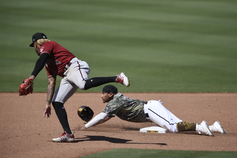 San Diego Padres' Josh Naylor, bottom, slides past second base on a steal attempt next to Arizona Diamondbacks second baseman Ketel Marte during the seventh inning of a baseball game in San Diego, Sunday, July 26, 2020. Naylor was out. (AP Photo/Kelvin Kuo)