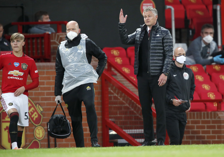 Manchester United's manager Ole Gunnar Solskjaer gestures during the English Premier League soccer match between Manchester United and Southampton at Old Trafford in Manchester, England, Monday, July 13, 2020. (AP Photo/Clive Brunskill,Pool)