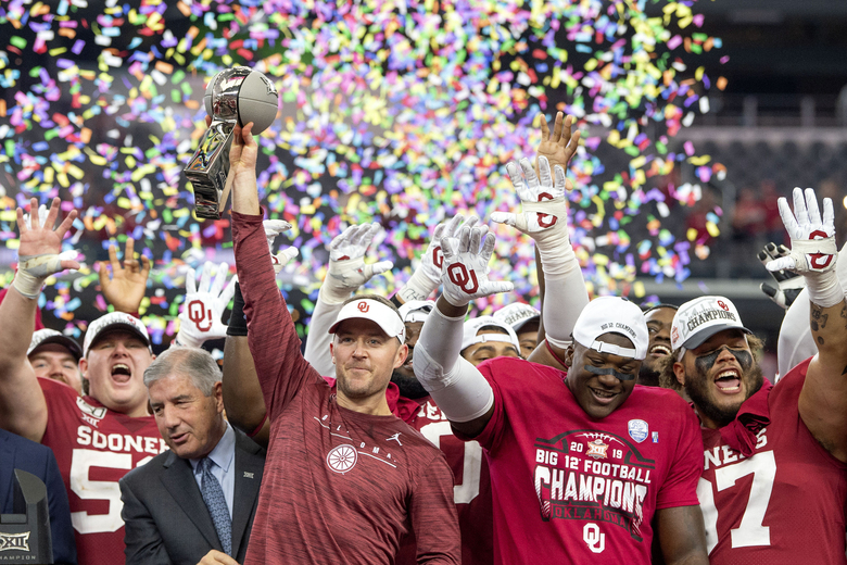 FILE – In this Dec. 7, 2019, file photo, Oklahoma head coach Lincoln Riley hosts the Big 12 Conference championship trophy after defeating Baylor 30-23 in overtime in an NCAA college football game in Arlington, Texas. Riley will earn an average of more than $7.5 million a year under a contract extension through the 2025 season. The university's board of regents approved the two-year extension Tuesday, July 28, 2020. (AP Photo/Jeffrey McWhorter, File)