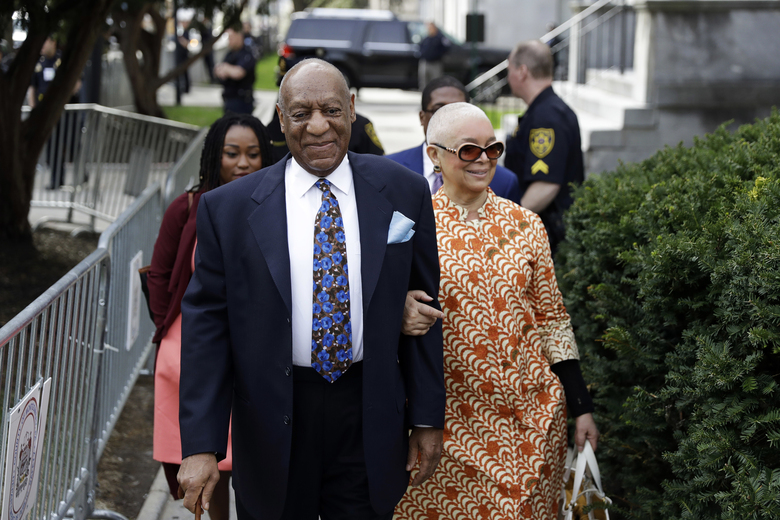 FILE – In this April 24, 2018, file photo, Bill Cosby, left, arrives with his wife, Camille Cosby, for his sexual assault trial at the Montgomery County Courthouse in Norristown, Pa. Cosby was convicted of sexual assault in 2018. He is serving up to 10 years in prison. Now in the midst of another historic reckoning, this time addressing the treatment of African Americans and other people of color by police and the criminal justice system, the 82-year-old Cosby has won the right to an appeal. (AP Photo/Matt Slocum, File)