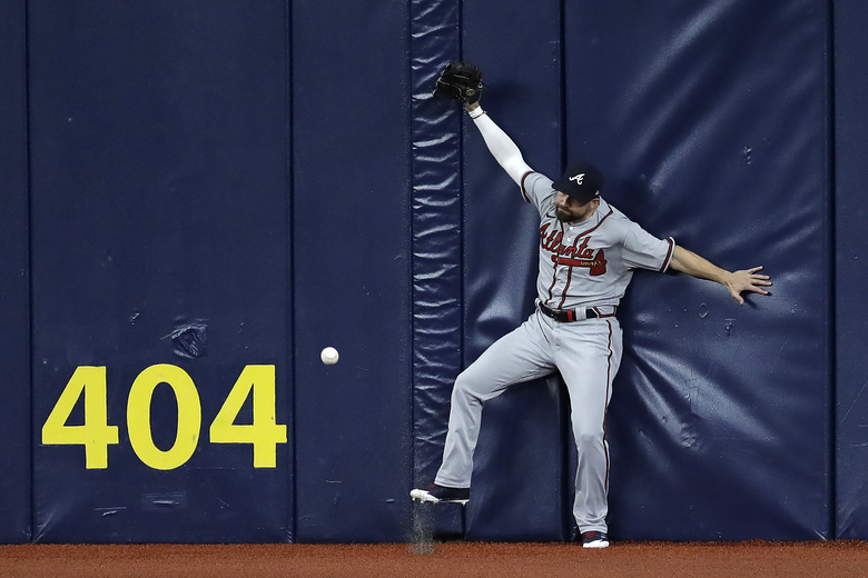 Atlanta Braves center fielder Ender Inciarte can't make the catch on a two-run triple by Tampa Bay Rays' Brandon Lowe during the fourth inning of a baseball game Monday, July 27, 2020, in St. Petersburg, Fla. (AP Photo/Chris O'Meara)
