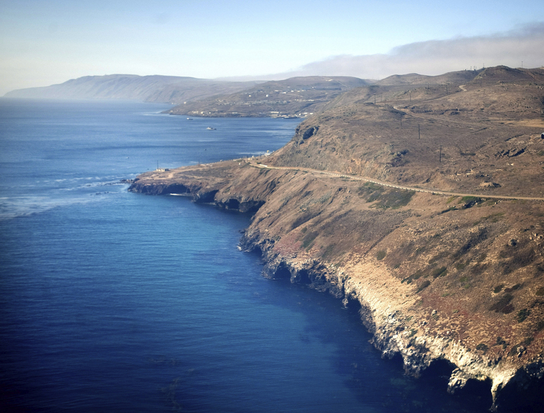 In this July 16, 2013, photo is an aerial view of the coast and Pacific Ocean taken flying in to San Clemente Island, in San Diego. A military seafaring assault vehicle that sank off the coast of Southern California with Marines and one Navy corpsman on board is under hundreds feet of water, making it impossible for divers to reach the landing craft and complicating rescue efforts for the missing troops, officials said Friday, July 31, 2020. (Mindy Schauer/The Orange County Register via AP)