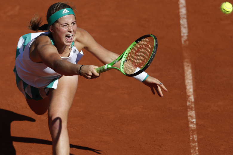 FILE — In this June 8, 2017 file photo Latvia's Jelena Ostapenko plays a shot against Timea Bacsinszky of Switzerland during their semifinal match of the French Open tennis tournament at the Roland Garros stadium, in Paris, France. With second-ranked Simona Halep joined by 2017 French Open champion Jeļena Ostapenko and last year's Roland Garros finalist Markéta Vondroušová, this year's Palermo Ladies Open, the Aug. 3-9 event marking the return of tour-level tennis following a five-month break for the coronavirus pandemic, will be like no other. (AP Photo/Petr David Josek)