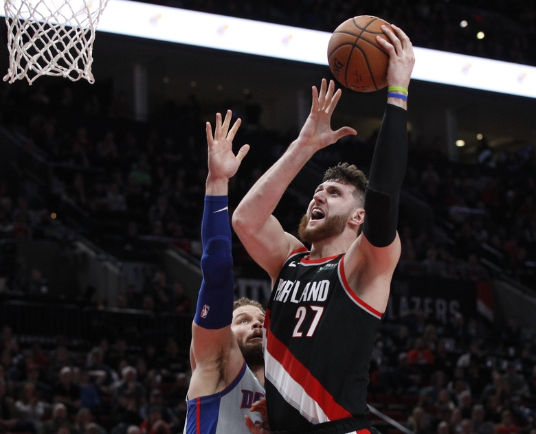 FILE – In this March 23, 2019, file photo, Portland Trail Blazers center Jusuf Nurkic, right, shoots as Detroit Pistons forward Blake Griffin defends during the second half of an NBA basketball game in Portland, Ore. Jusuf Nurkic is back and healthy. So are Zach Collins, Meyers Leonard, Giannis Antetokounmpo, Anthony Davis and plenty of others. If the four-month NBA shutdown had a silver lining, it's that a lot of ailing players got well.  (AP Photo/Steve Dipaola, File)
