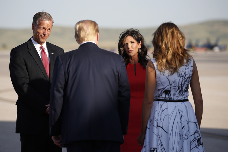 Sen. John Thune, R-S.D., and Gov. Kristi Noem greet President Donald Trump and first Lady Melania Trump upon arrival at Ellsworth Air Force Base, Friday, July 3, 2020, in Rapid City, S.D. Trump is en route to Mount Rushmore National Memorial. (Alex Brandon / The Associated Press)