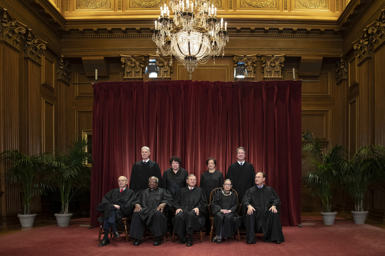 FILE – In this Nov. 30, 2018, file photo, the justices of the U.S. Supreme Court gather for a formal group portrait to include a new Associate Justice, top row, far right, at the Supreme Court Building in Washington. Seated from left: Associate Justice Stephen Breyer, Associate Justice Clarence Thomas, Chief Justice of the United States John G. Roberts, Associate Justice Ruth Bader Ginsburg and Associate Justice Samuel Alito Jr. Standing behind from left: Associate Justice Neil Gorsuch, Associate Justice Sonia Sotomayor, Associate Justice Elena Kagan and Associate Justice Brett M. Kavanaugh. (AP Photo/J. Scott Applewhite, File)