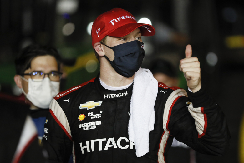 Josef Newgarden reacts in Victory Lane after winning the IndyCar Series auto race Saturday, July 18, 2020, at Iowa Speedway in Newton, Iowa. (AP Photo/Charlie Neibergall)