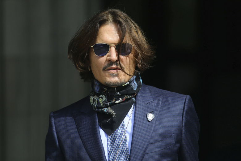 "Actor Johnny Depp arrives at the High Court for a hearing in his libel case, in London, Friday,  July 24, 2020. Depp is suing News Group Newspapers, publisher of The Sun, and the paper's executive editor, Dan Wootton, over an April 2018 article that called him a ""wife-beater."" The Sun's defense relies on a total of 14 allegations by his ex-wife, actress Amber Heard of Depp's violence. He strongly denies all of them. (Aaron Chown/PA via AP)"