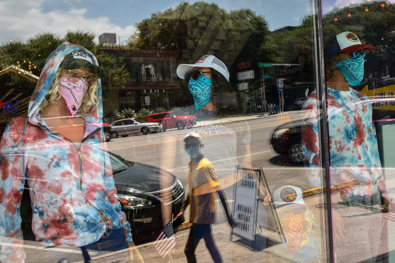Mask-wearing mannequins at a store in Austin's South Congress neighborhood. Texas is among the states that have rolled back their reopenings amid a spike in coronavirus cases. Florida also reversed course on loosened restrictions after Gov. Ron DeSantis, a Republican, pushed for a quick recovery. (Photo by Tamir Kalifa for The Washington Post).