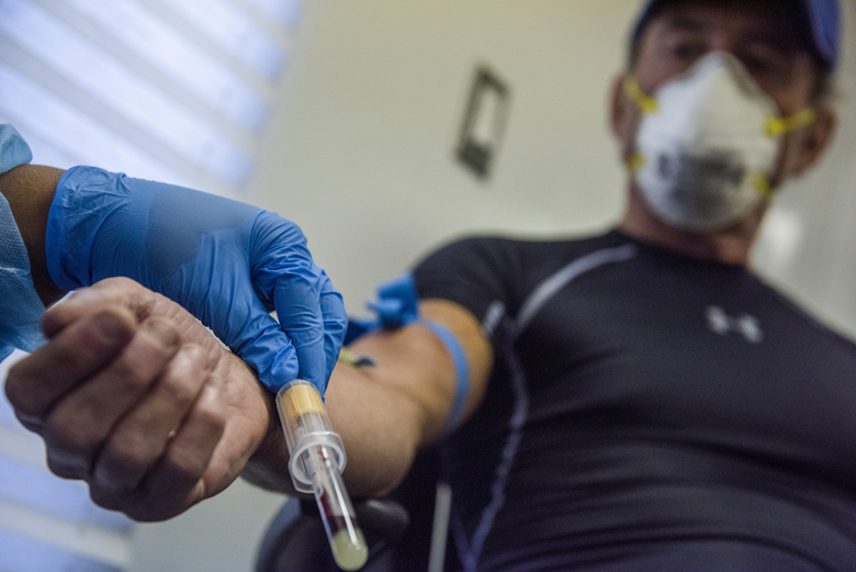 A nurse draws blood last month for an antibody test at a District of Columbia testing site. (Photo of for The Washington Post by Amanda Voisard).