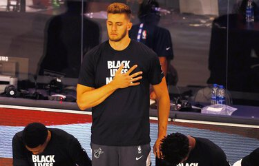 Miami Heat's Meyers Leonard stands during the national anthem before an NBA basketball game against the Denver Nuggets, Saturday, Aug. 1, 2020, in Lake Buena Vista, Fla. (Kevin C. Cox/Pool Photo via AP) GETI511 GETI511