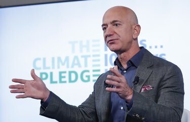Amazon CEO Jeff Bezos arrives to begin his news conference at the National Press Club in Washington, Thursday, Sept. 19, 2019. Bezos announced the Climate Pledge, setting a goal to meet the Paris Agreement 10 years early. (AP Photo/Pablo Martinez Monsivais)