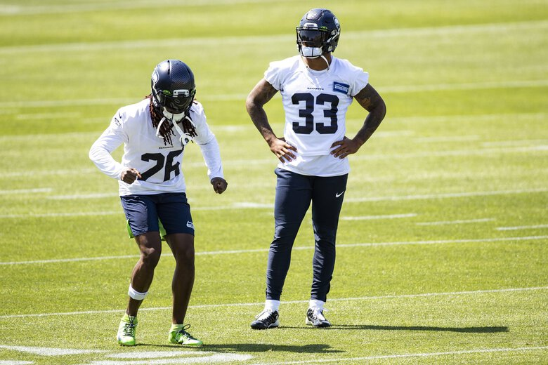 Seahawks cornerback Shaquill Griffin works with safety Jamal Adams as the Seattle Seahawks hold training camp at the Virginia Mason Athletic Center in Renton Thursday August 13, 2020. (Bettina Hansen / The Seattle Times)