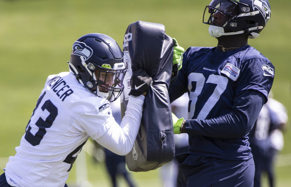 Defensive end Eli Mencer (43) goes through drills Thursday.  The Seattle Seahawks practiced Thursday, August 13, 2020 at the VMAC in Renton, WA. (Dean Rutz / The Seattle Times)