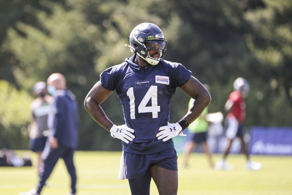 DK Metcalf gets extra reps in with Russell Wilson following Thursday's practice.  The Seattle Seahawks practiced Thursday, August 13, 2020 at the VMAC in Renton, WA. (Dean Rutz / The Seattle Times)