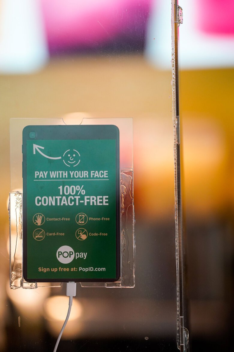 A payment register at Lemonade with a PopPay unit mounted on the sneeze guard on  Aug. 5 in Pasadena, CA. PopID that makes facial recognition systems for payment at restaurants and retail outlets, and for keyless entry for employees. (Kent Nishimura / Los Angeles Times)
