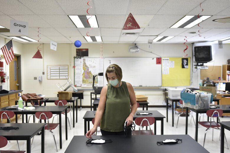 Science teacher Camille Flournoy sets out masks for her students Tuesday, Aug. 18, 2020, at O'Leary Middle School in Twin Falls, Idaho.  (Drew Nash / The Associated Press)
