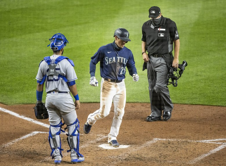 Dylan Moore hit a solo home run in the 6th off Dodgers's reliever Pedro Baez.   (Dean Rutz / The Seattle Times)