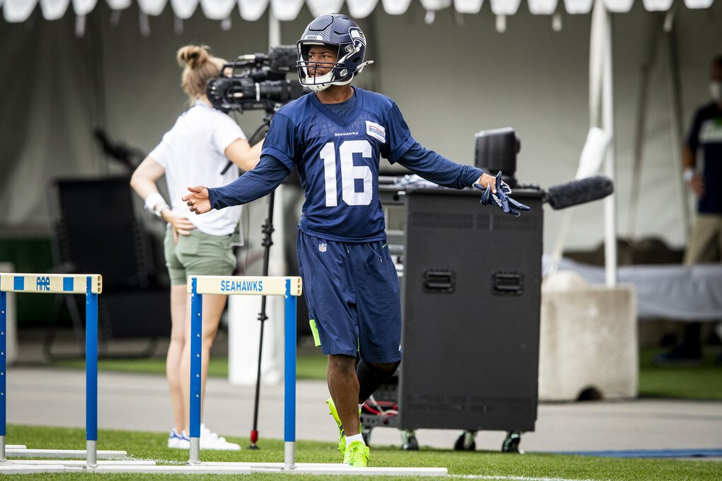 There might not be the usual roar from fans for Seahawks wide receiver Tyler Lockett, but he does a flashy intro for the camera as he jogs onto the field. (Bettina Hansen / The Seattle Times)