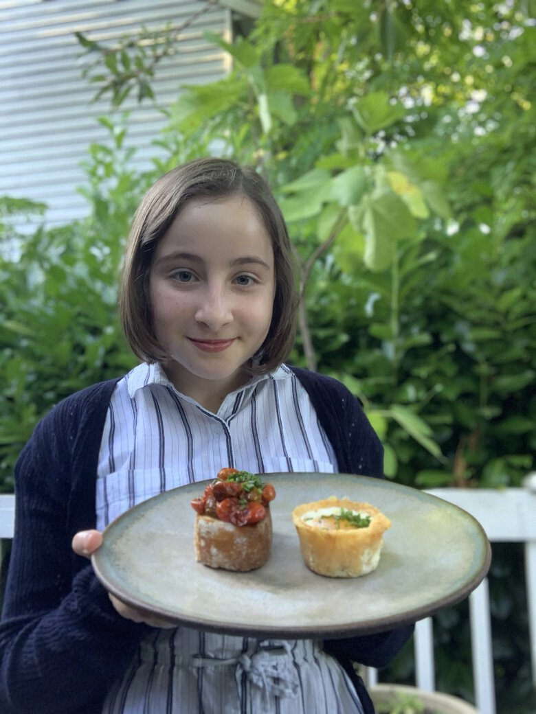 One of Sadie Davis-Suskind's favorite breakfast dishes is parmesan egg cups, served with blistered cherry tomato toast.  (Rebecca Davis-Suskind)