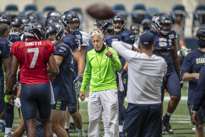 Pete Carroll runs his team's warm up before Saturday's scrimmage.  The Seattle Seahawks held a scrimmage game at CenturyLink Field Saturday, August 22, 2020. (Dean Rutz / The Seattle Times)