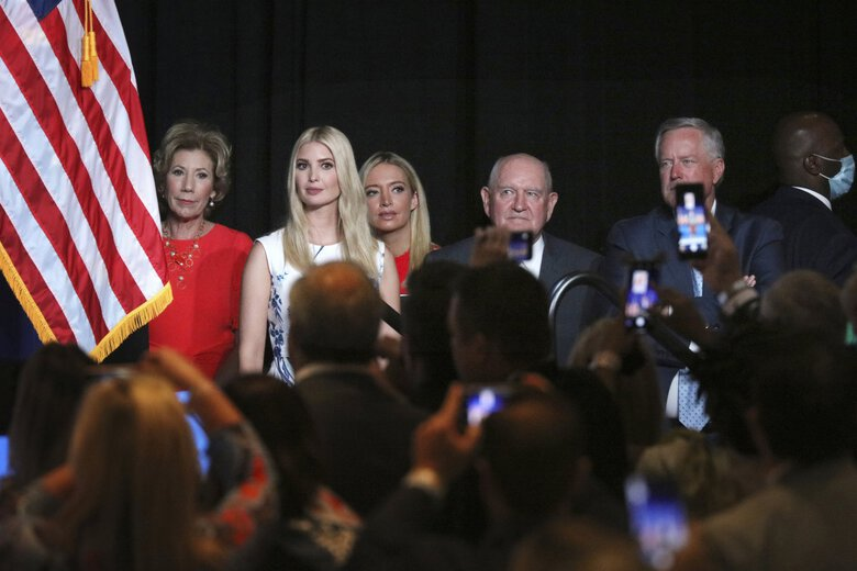 Ivanka Trump, the daughter and senior adviser to the president, second from left, and White House Chief of Staff Mark Meadows, right, and members of the White House staff listen as President Trump speaks during the first day of the Republican National Convention on Monday, Aug. 24, 2020, in Charlotte, N.C. (Travis Dove / The New York Times via AP, Pool)