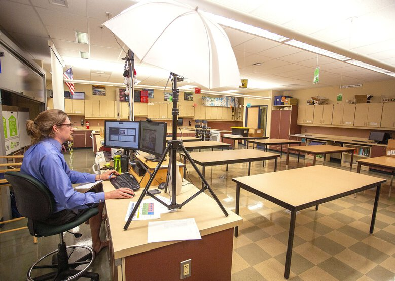 Science teacher Geoff Reilly teaches an online class from his empty classroom on the first day of school Wednesday at Lincoln Middle School in Pullman, Wash. Pullman public schools are starting the school year with online classes to help prevent the spread of the coronavirus. (Geoff Crimmins / The Associated Press)
