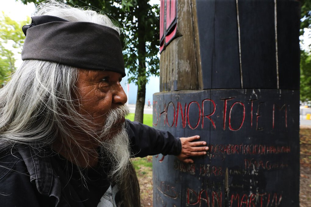 "By carving the honor totem pole for his brother in 2012, Rick Williams said, ""I hope that it will be a symbol of peace and honor for many generations."" (Alan Berner / The Seattle Times)"