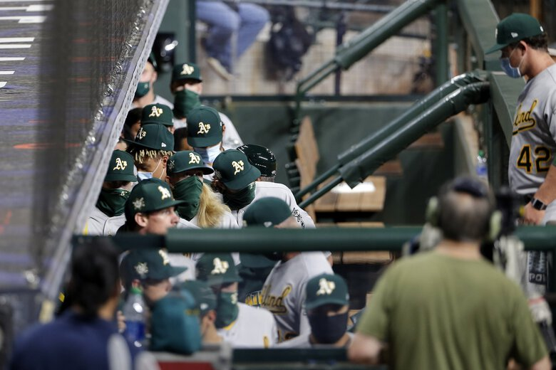 Oakland Athletics players walk out of the dugout in protest of racial injustice before their baseball game against the Houston Astros, Friday, Aug. 28, 2020, in Houston. (Michael Wyke / The Associated Press)