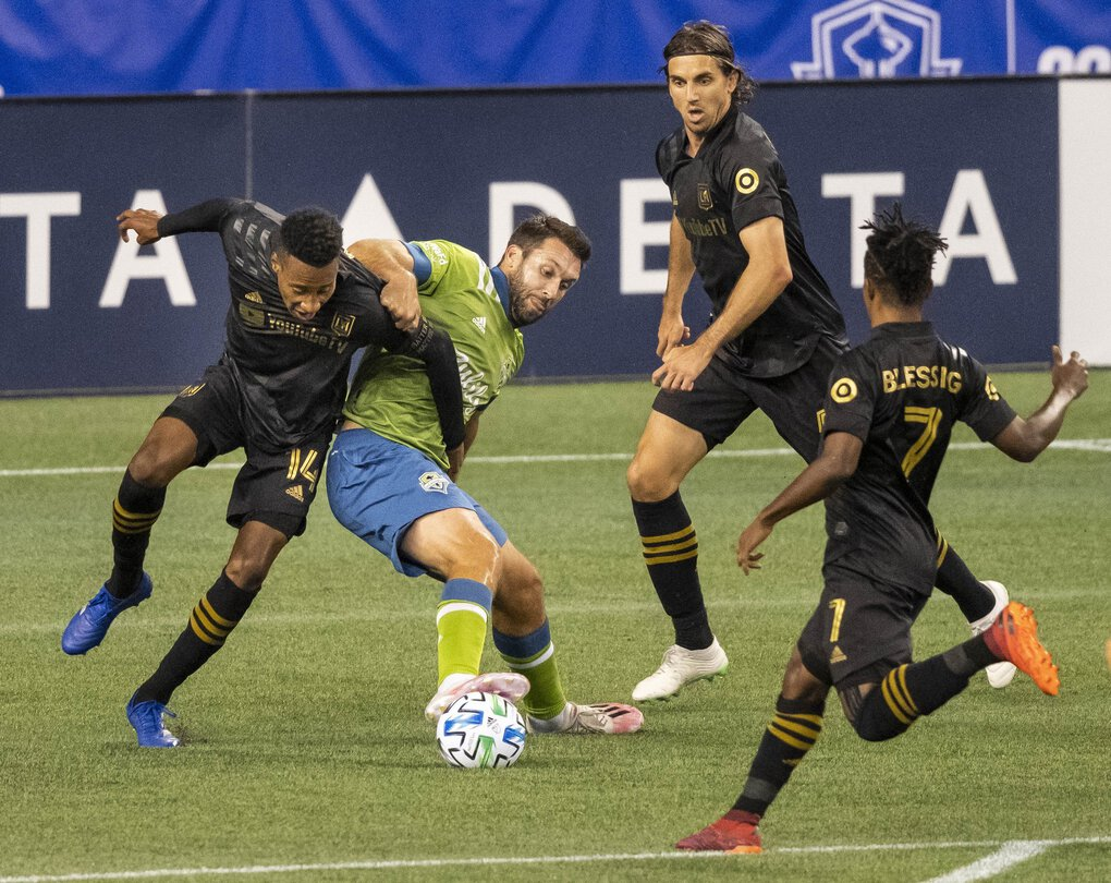 Seattle's Will Bruin is outnumbered at the top of the LAFC box in the 2nd half of play.  The Seattle Sounders played their first game in CenturyLink Field since March – against rival LAFC Sunday August 30, 2020. (Dean Rutz / The Seattle Times)