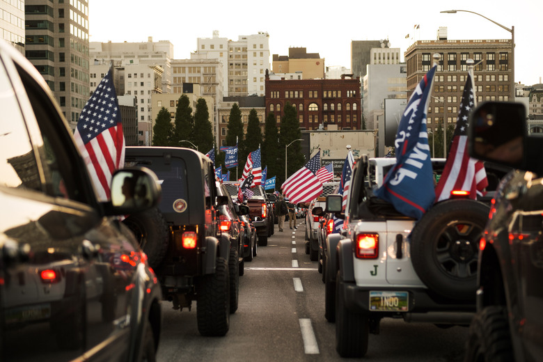 Supporters of President Donald Trump drive  into Portland, Ore., Aug. 29, 2020. On Saturday night, the caravan of supporters of President Trump traveled through the city, clashing with counterprotesters. A man was shot and killed during the unrest. (Mason Trinca/The New York Times)