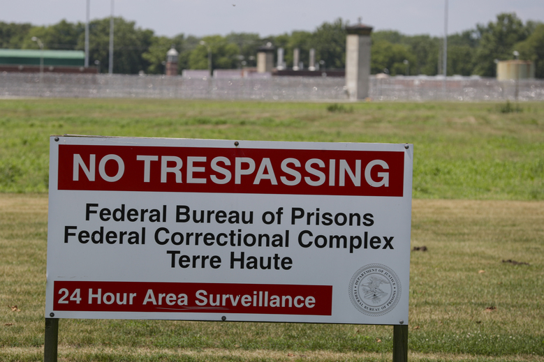 A No Trespassing sign stands in front of the federal prison complex in Terre Haute, Ind. Friday, July 17, 2020. A judge in Washington is halting for now the government's planned Friday execution at the federal prison in Terre Haute, Indiana of Keith Dwayne Nelson who was convicted of kidnapping, raping and murdering at 10-year-old Kansas girl. (AP Photo/Michael Conroy)