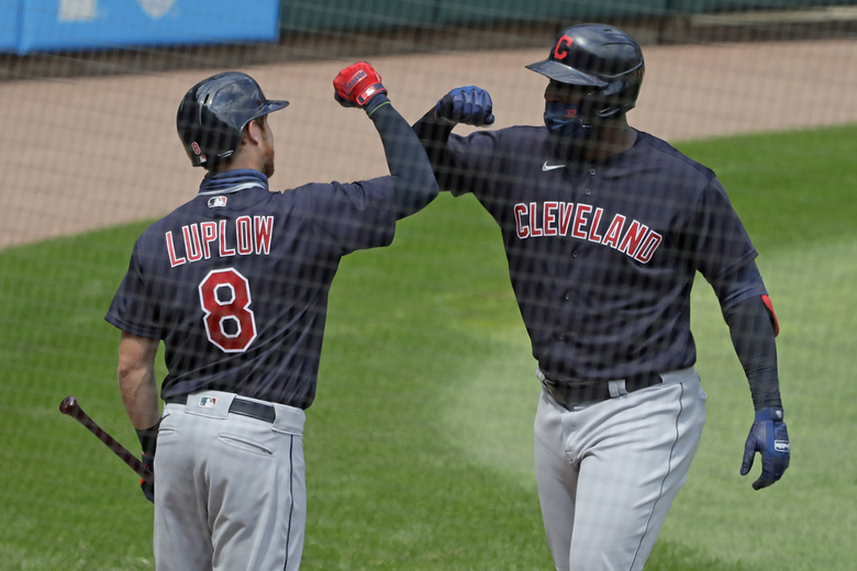 Cleveland Indians' Franmil Reyes, right, celebrates with Jordan Luplow after hitting a two-run home run during the fourth inning of a baseball game against the Chicago White Sox in Chicago, Saturday, Aug. 8, 2020. (AP Photo/Nam Y. Huh)