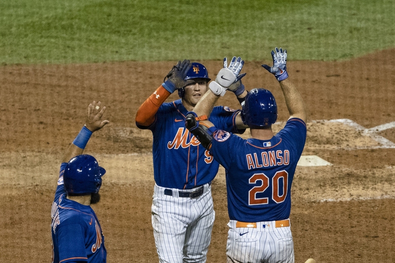 New York Mets' Luis Guillorme, left, celebrates with teammates Brandon Nimmo (9) and Pete Alonso (20) after a two-run double by Michael Conforto during the sixth inning of a baseball game Wednesday, Aug. 12, 2020, in New York. (AP Photo/Frank Franklin II)