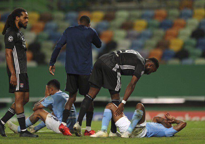 Manchester City's Gabriel Jesus, left, and Manchester City's Raheem Sterling react at the end of the Champions League quarterfinal soccer match between Lyon and Manchester City at the Jose Alvalade stadium in Lisbon, Portugal, Saturday, Aug. 15, 2020. Lyon won the match 3-1. (Miguel A. Lopes/Pool via AP)