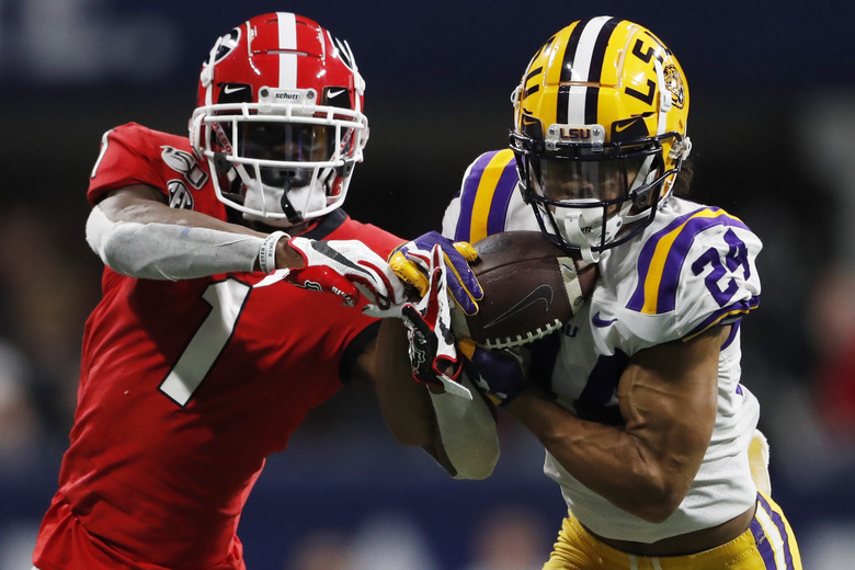 FILE – In this Dec. 7, 2019, file photo, LSU cornerback Derek Stingley Jr. (24) intercepts the ball from Georgia wide receiver George Pickens (1) during the second half of the Southeastern Conference championship NCAA college football game in Atlanta. Stingley Jr. was selected to The Associated Press preseason All-America first-team, Tuesday, Aug. 25, 2020. (AP Photo/John Bazemore, File)