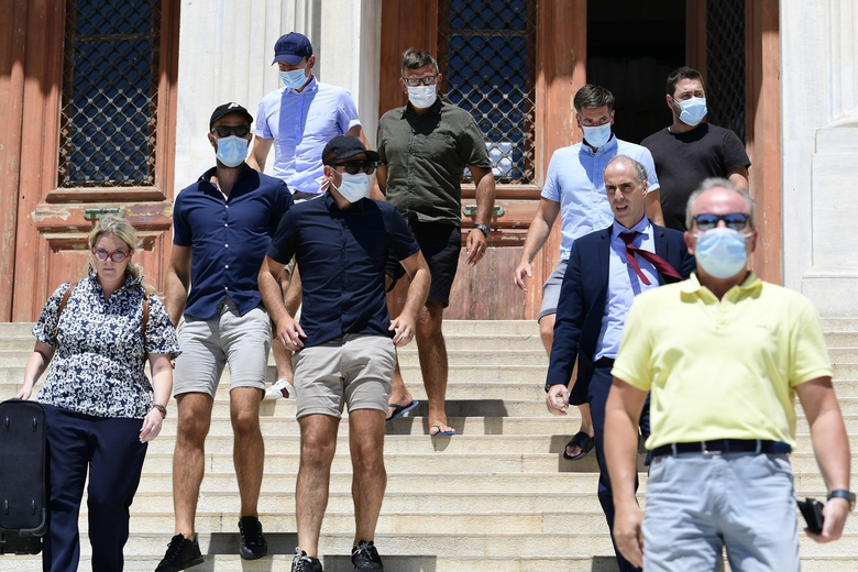England soccer player Harry Maguire, background left, leaves a court building on the Aegean island of Syros, Greece, on Saturday, Aug. 22, 2020. The Manchester United captain was arrested during a brawl on the neighbouring holiday island of Mykonos. (AP Photo/Michael Varaklas)