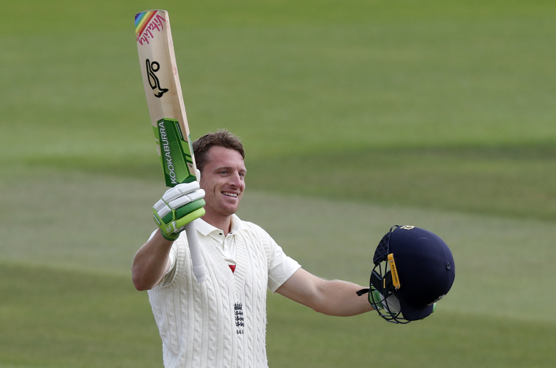 England's Jos Buttler raises his bat and helmet to celebrate scoring a century during the second day of the third cricket Test match between England and Pakistan, at the Ageas Bowl in Southampton, England, Saturday, Aug. 22, 2020. (AP Photo/Alastair Grant, Pool)