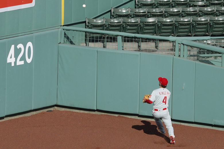 Philadelphia Phillies' Scott Kingery tries to track down an RBI double by Boston Red Sox's Jackie Bradley Jr. during the eighth inning of a baseball game Wednesday, Aug. 19, 2020, at Fenway Park in Boston. (AP Photo/Winslow Townson)