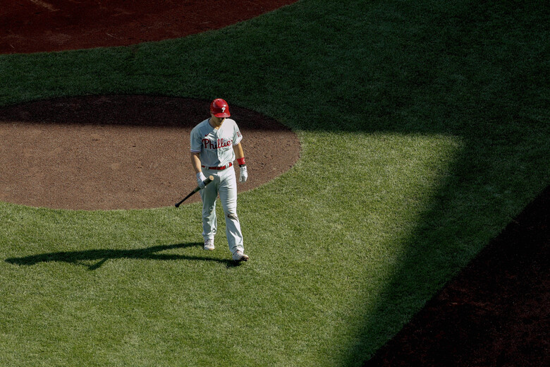 Philadelphia Phillies' J.T. Realmuto heads back to the dugout after striking out during the seventh inning of a baseball game against the Boston Red Sox Wednesday, Aug. 19, 2020, at Fenway Park in Boston. (AP Photo/Winslow Townson)