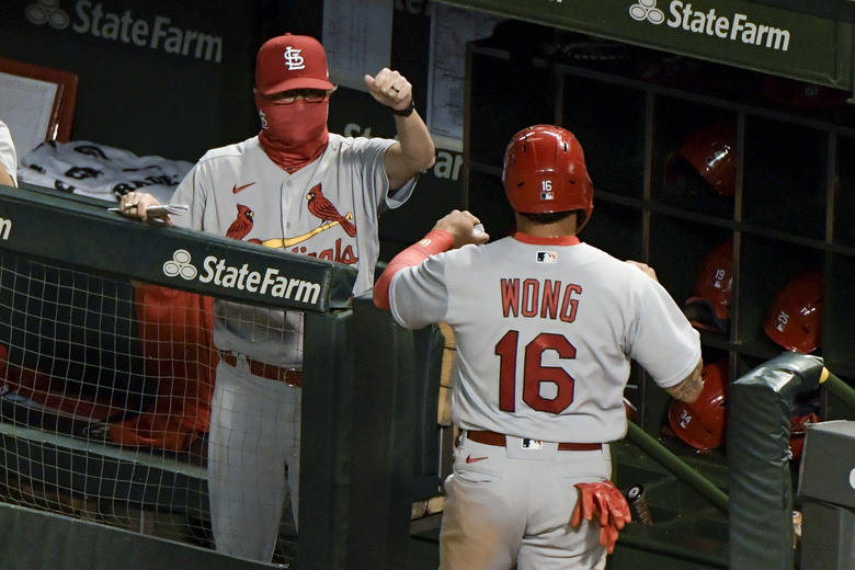 St. Louis Cardinals' Kolten Wong (16) is congratulated after scoring on a single by Paul Goldschmidt during the fifth inning of a baseball game against the Chicago Cubs on Tuesday, Aug. 18, 2020, in Chicago. (AP Photo/Mark Black)