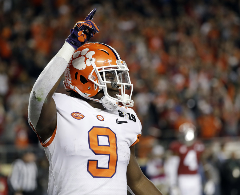 FILE – In this Jan. 7, 2019, file photo, Clemson's Travis Etienne celebrates his touchdown run during the first half the NCAA college football playoff championship game against Alabama, in Santa Clara, Calif. Clemson is preseason No. 1 in The Associated Press Top 25, Monday, Aug. 24, 2020, a poll featuring nine Big Ten and Pac-12 teams that gives a glimpse at what's already been taken from an uncertain college football fall by the pandemic. (AP Photo/Chris Carlson, File)