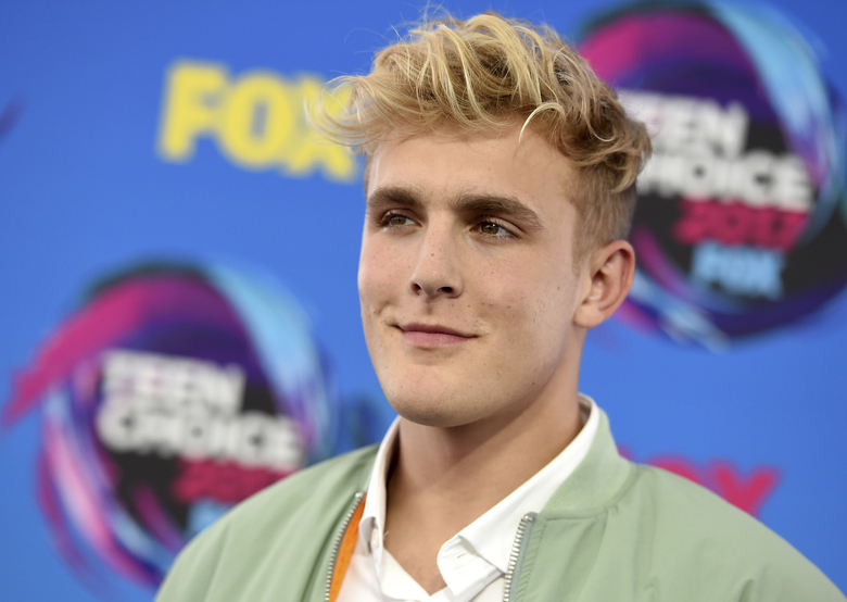 FILE – Internet personality Jake Paul arrives at the Teen Choice Awards in Los Angeles on Aug. 13, 2017. FBI agents including a SWAT team have raided the apparent home of YouTube star Jake Paul. FBI spokeswoman Laura Eimiller says agents executed a search warrant Wednesday at the Calabasas, California mansion in connection with an ongoing investigation. She could not say what the probe is about or who the target was. Helicopter video from local TV news showed agents gathering guns from the home that can frequently be seen on Paul's YouTube channel, which has over 20 million followers. (Photo by Jordan Strauss/Invision/AP, File)