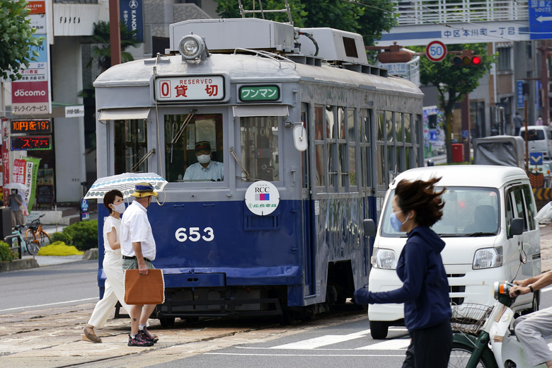 The No. 653 tram, which survived the atomic bomb, runs along the street near the Atomic Bomb Dome to commemorate the 75th anniversary of the U.S. first atomic bombing on the city in Hiroshima, Japan, Thursday, Aug. 6, 2020. (AP Photo/Eugene Hoshiko)