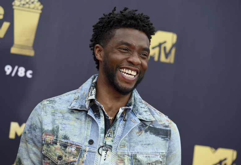 FILE – In this Saturday, June 16, 2018 file photo, Chadwick Boseman arrives at the MTV Movie and TV Awards at the Barker Hangar in Santa Monica, Calif.  Actor Chadwick Boseman, who played Black icons Jackie Robinson and James Brown before finding fame as the regal Black Panther in the Marvel cinematic universe, has died of cancer. His representative says Boseman died Friday, Aug. 28, 2020 in Los Angeles after a four-year battle with colon cancer. He was 43. (Photo by Jordan Strauss/Invision/AP, File)