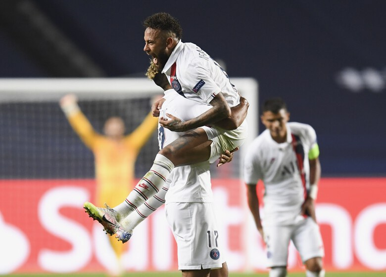 PSG's Neymar celebrates with teammate Eric Maxim Choupo-Moting after his team's win in the Champions League quarterfinal match between Atalanta and PSG at Luz stadium, Lisbon, Portugal, Wednesday, Aug. 12, 2020. (David Ramos/Pool Photo via AP)