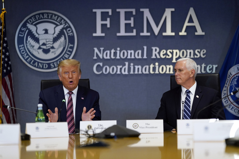 President Donald Trump speaks during a Hurricane Laura briefing at FEMA headquarters, Thursday, Aug. 27, 2020, in Washington. Vice President Mike Pence listens at right. (AP Photo/Evan Vucci)