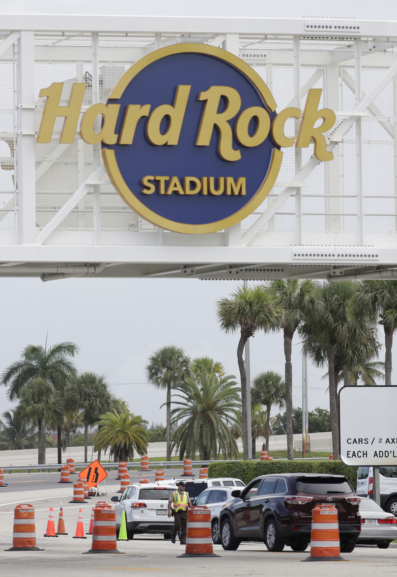 Cars are in line to enter, Wednesday, Aug. 5, 2020, a COVID-19 testing site outside Hard Rock Stadium in Miami Gardens, Fla. State officials say Florida has surpassed 500,000 coronavirus cases. Meanwhile, testing is ramping up following a temporary shutdown of some sites because of Tropical Storm Isaias. (AP Photo/Wilfredo Lee)